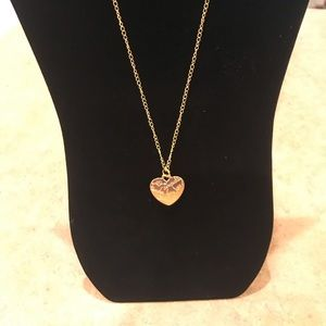 Gold heart pendant on an 18 inch chain.